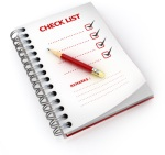 checklist written on spiral notebook with pencil